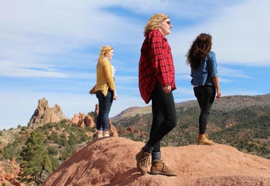 3 girls on hill