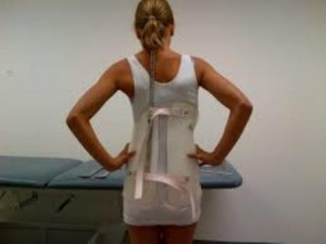 woman sizing the back brace