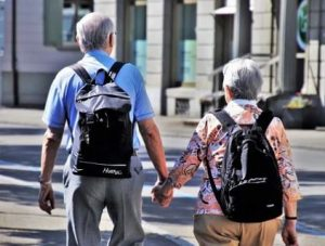 aged couple walking